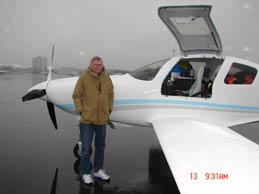 Bill Harrelson in front of his aircraft